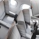 New economy class seat with deployable padded wings for passengers to lean on unveiled
