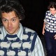 Harry Styles shows of his sartorial flair in a quirky sheep print sweater