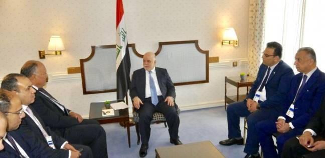 شكري يبحث مساهمة مصر في إعادة إعمار العراق مع العبادي في ميونيخ