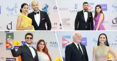حب على السجادة الحمراء.. شاهد النجوم ونصفهم الحلو بافتتاح مهرجان الجونة